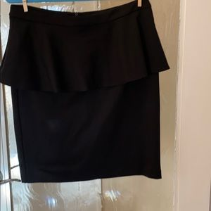 Black skirt with ruffle on to.